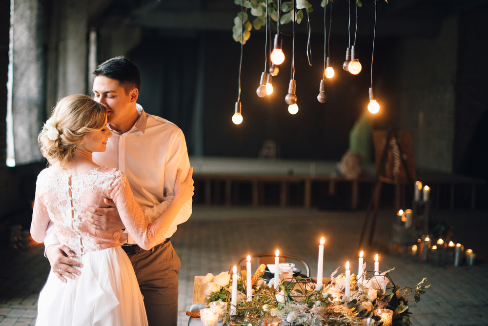 lighting candle with couple- upload article