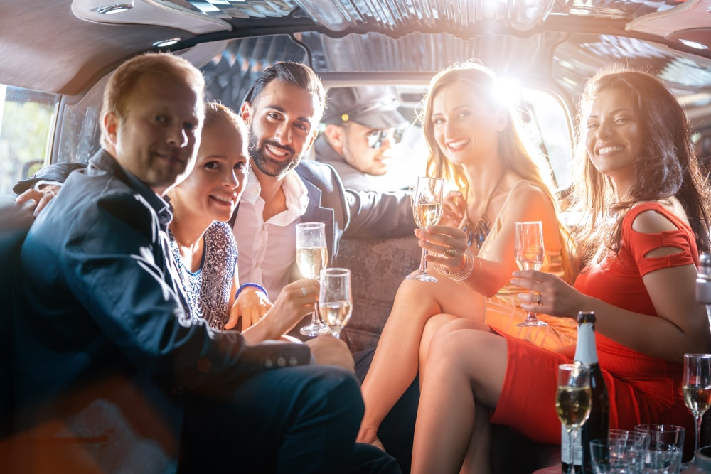 friends drink and enjoy in limo