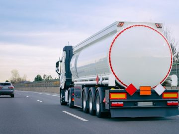 A freight trucks parking lot with fuel tank